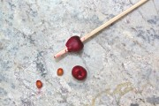 pitting cherries with chopstick