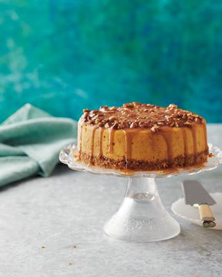Praline Pumpkin Cheesecake with Caramel Sauce